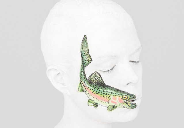 """A painted trout on a person's mouth, taken in Leicester, England. An artist is challenging the derogatory terms we use to describe the human body – by painting them onto the human body. Leicester-based body painter, Emma Fay, created her new series """"Ridiculous"""" alongside creatives Juliette Burton and Adam Person. The new project questions how certain terminology may be affecting our mental health and how we perceive body image. (Photo by Emma Fay/Barcroft Images)"""