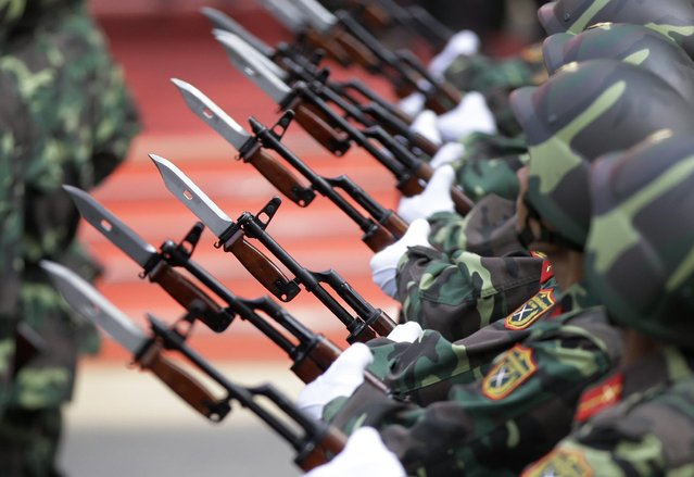 Bayonets are fixed to the barrels of Vietnamese soldiers' rifles during a parade celebrating the 40th anniversary of the end of the Vietnam War which is also remembered as the fall of Saigon, in Ho Chi Minh City, Vietnam, Thursday, April 30, 2015. (Photo by Dita Alangkara/AP Photo)