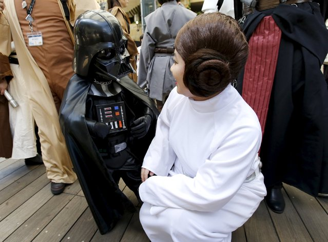 Cosplayers dressed up as Star Wars characters Darth Vader (L) and Princess Leia talk at a Star Wars Day fan event in Tokyo May 4, 2015. (Photo by Toru Hanai/Reuters)
