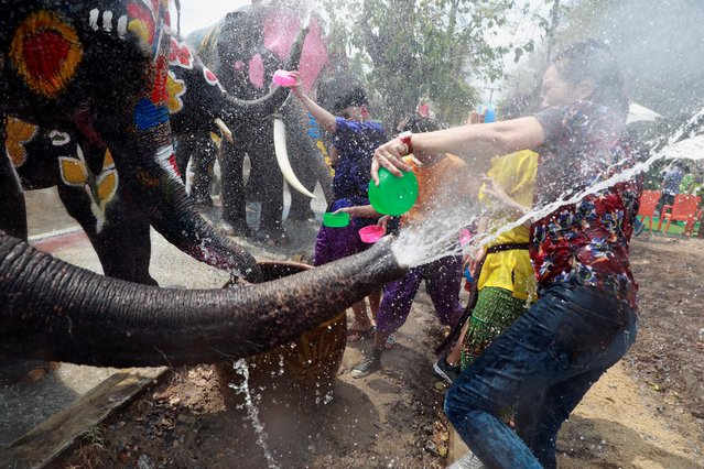 Elephants and people play with water as part of celebrations for the water festival of Songkran, which marks the start of the Thai New Year in Ayutthaya, Thailand on April 11, 2019. (Photo by Soe Zeya Tun/Reuters)