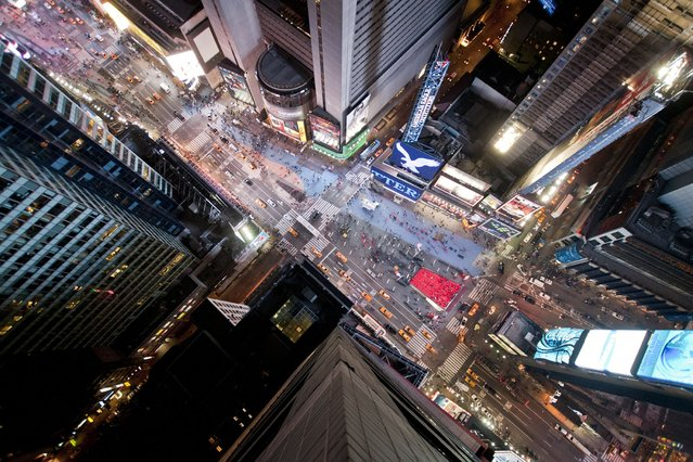 A photo of Times Square from the top of a building taken by adventure photographer Lucinda Grange during a trip to the Big Apple in New York City. (Photo by Lucinda Grange/Barcroft USA)