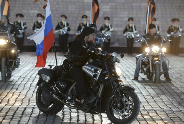 "Leader of the motorcycling club Night Wolves Alexander Zaldostanov, nicknamed ""Khirurg"" (Surgeon), performs during a festive concert marking the 70th anniversary of the end of World War Two in Europe, at Red Square in Moscow, Russia, May 9, 2015. (Photo by Reuters/Host Photo Agency/RIA Novosti)"