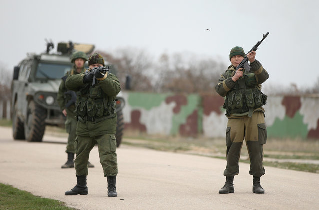 Troops under Russian command fire weapons into the air and scream orders to turn back at an approaching group of over 100 hundred unarmed Ukrainian troops at the Belbek airbase, which the Russian troops are occcupying, in Crimea on March 4, 2014 in Lubimovka, Ukraine. (Photo by Sean Gallup/Getty Images)