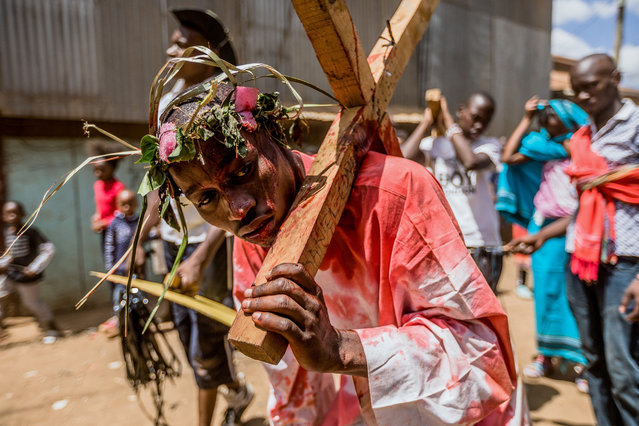 Christian devotees reenact the Way of the Cross, or Jesus Christ's passion, during a Good Friday commemoration in the Kibera slum of Nairobi on April 19, 2019. (Photo by Brian Otieno/AFP Photo)