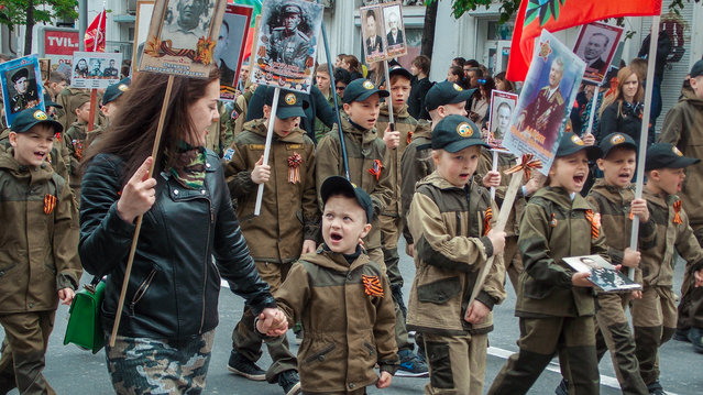 Children in Sevastopol wear the orange and black ribbon of St. George, a Russian military symbol. (Photo by Radio Free Europe/Radio Liberty)