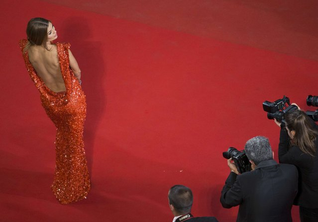 "A guest poses on the red carpet as she arrives for the screening of the film ""Mon roi"" in competition at the 68th Cannes Film Festival in Cannes, southern France, May 17, 2015. (Photo by Yves Herman/Reuters)"