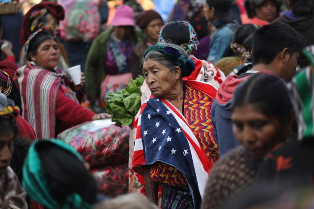 Maria Isabel Luna, 75, wears an American towel for warmth over her traditional Mayan dress while working at a vegetable market on February 11, 2017 in Almolonga, Guatemala. (Photo by John Moore/Getty Images)