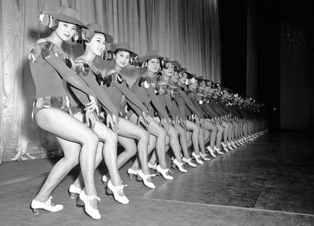 """Japanese dancers of the Schochiku dancing troupe rehearse one of their new numbers in the """"natsu-no-odori"""" summer dance scene which they performed at the Kokusai Theater in Tokyo on July 11, 1958. (Photo by Mitsunori Chigita/AP Photo via The Atlantic)"""