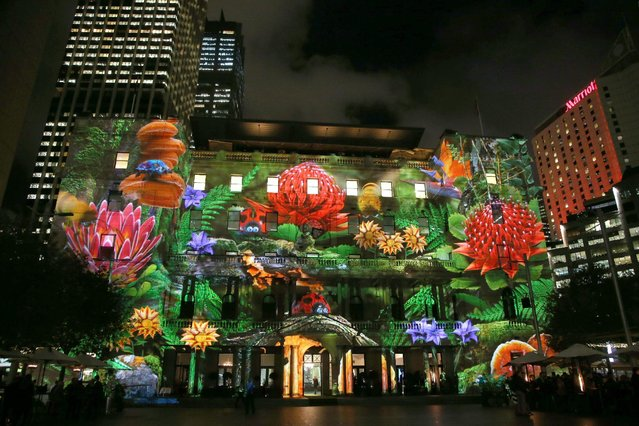 A garden scene is projected onto Customs House as part of the Vivid festival in Sydney, Thursday, May 21, 2015. Projections, interactive displays and sound form the annual Vivid Sydney festival of display, light, music and ideas that runs until June 8. (Photo by Rick Rycroft/AP Photo)