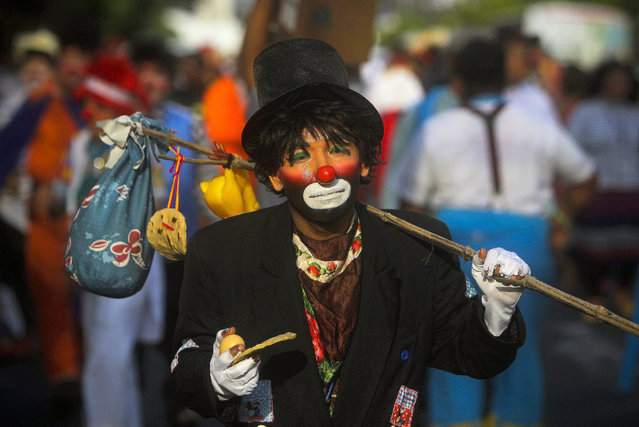 A clown takes part in a parade in San Salvador, El Salvador, 20 May 2015. The Clowns International Convention is part of the VII Laugh Fair. (Photo by Oscar Rivera/EPA)