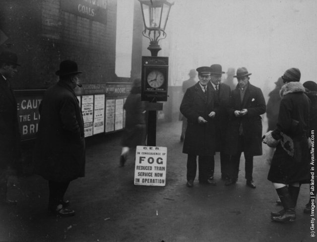 1927: A scene at Woodford, where city workers were informed that fog may delay their journeys to work