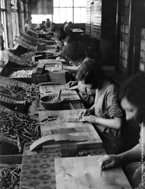 1930: A production line in a fireworks factory at the Standards Works in Huddersfield, Yorkshire