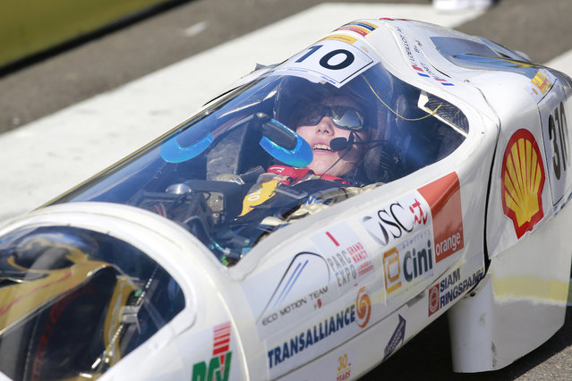 The driver of The Vir'Volt, #310, a battery electric Prototype, competing for Eco Motion Team from ESSTIN Nancy, prepares to head onto the track during the final day of the Shell Eco-marathon Europe 2015 on Sunday, May 24, 2015, in Rotterdam, the Netherlands. (Photo by Jiri Buller/AP Images for Shell)