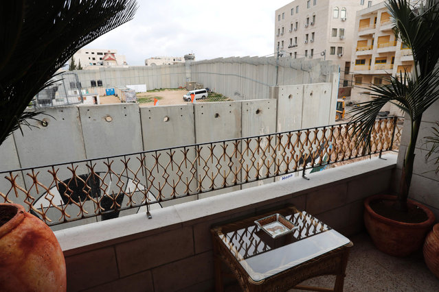 A picture taken from street artist Banksy's newly opened Walled Off hotel in the Israeli occupied West Bank town of Bethlehem, on March 3, 2017, shows Israel's controversial separation wall. Secretive British street artist Banksy opened a hotel next to Israels controversial separation wall in Bethlehem on Friday, his latest artwork in the Palestinian territories. (Photo by Thomas Coex/AFP Photo)