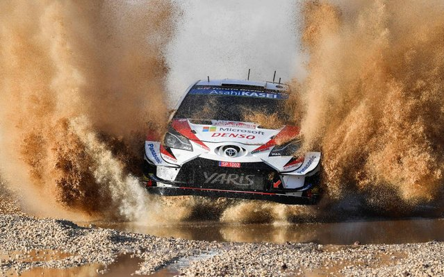 Finnish driver Juho Hanninen and co-driver Tomi Tuominen steer their Toyota Yaris WRC during the SS1 Super Special Shakedown stage of the Rally of Sardegna at the Ittiri arena on June 13, 2019. (Photo by Andreas Solaro/AFP Photo)