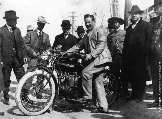 1914: Mexican rebel leader Francisco 'Pancho' Villa (1877-1923) with one of the motorcycles used in the Battle of Torrero