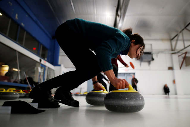 """A Yazidi refugee from Kurdistan learns the sport of curling at the Royal Canadian Curling Club during an event put on by the """"Together Project"""", in Toronto, March 15, 2017. (Photo by Mark Blinch/Reuters)"""