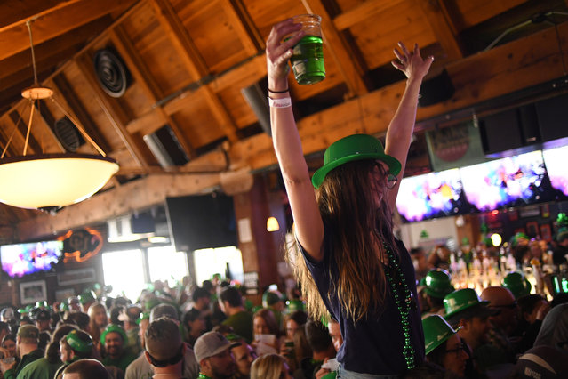 A women dances to the music, on top of her friend shoulders, during the 12th annual Keggs and Eggs event at Blake Street Tavern on March 17, 2017 in Denver, Colorado. (Photo by R.J. Sangosti/The Denver Post via Getty Images)