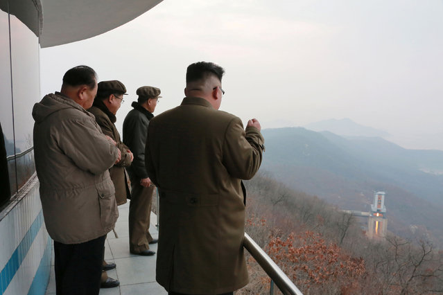 North Korean leader Kim Jong Un watched the ground jet test of a Korean-style high-thrust engine newly developed by the Academy of the National Defence Science in this undated picture provided by KCNA in Pyongyang on March 19, 2017. (Photo by Reuters/KCNA)