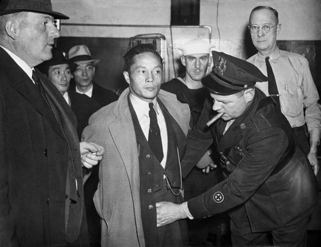 This December 7, 1941 file photo shows a Japanese man under arrest in the roundup at Norfolk, Va., being searched by a policeman after Japan's declaration of war on the U.S. Beliefs that Hispanics and Asians living in the U.S. won't assimilate or refuse to speak English are based on stereotypes that scholars say are linked to notions of white supremacy. Throughout American history, Hispanics and Asians have been pressured to adopt the customs of the mainstream white population. The pressure came even as some laws forbade them from voting, intermarrying and having access to education and public facilities. (Photo by AP Photo/File)