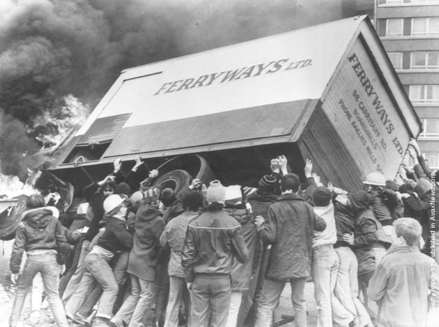 1981:  Rioters turn a burning lorry into a barricade in the Divis Flats area of Belfast, after violence erupted following the death of Irish Republican Army hunger striker and Member of Parliament Bobby Sands in the Maze prison