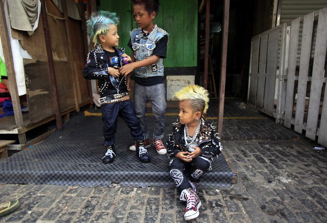 Myanmar children dressed as punks take part in the Thingyan water festival in Yangon, Myanmar, 12 April 2014. The annual water festival marks the traditional New Year in countries such as Myanmar, Thailand, Laos and Cambodia. (Photo by Lynn Bo Bo/EPA)
