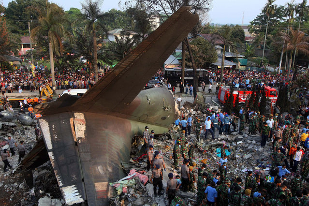 Indonesian rescuers search for victims of the crashed military airplane in Medan, North Sumatra, Indonesia, 30 June 2015. At least people 49 people were killed after an Indonesian military plane crashed in North Sumatra and burst into flames, officials said. Air Force chief Air Marshal Agus Supriatna said there were no survivors after the plane ploughed into houses and commercial buildings in Medan, the country's third largest city. (Photo by Dedi Sahputra/EPA)