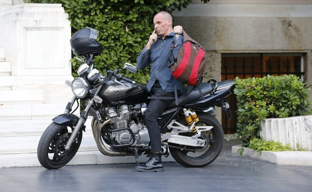 "Greek Finance Minister Yanis Varoufakis arrives on his motorbike prior to a meeting at the office of Prime Minister Alexis Tsipras in Maximos Mansion in Athens, Greece, July 1, 2015. Prime Minister Alexis Tsipras called on Greeks to vote ""no"" in Sunday's referendum on a bailout package offered by creditors, in a defiant address that dispelled speculation he was rowing back on the plan under mounting pressure. (Photo by Jean-Paul Pelissier/Reuters)"