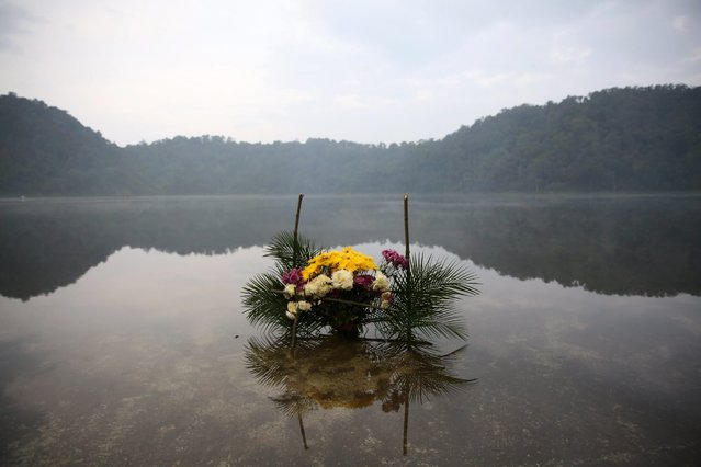 """A view of a floral offering at the Chikab'al Lake during the traditional ritual """"Prayer for rain"""" in San Martin Sacatequez, department of Quetzaltenango, Guatemala, 05 May 2016. The event is held during the winter in the country to bless the people's harvests. (Photo by Esteban Biba/EPA)"""