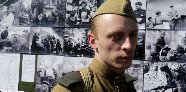A man wears a mock World War Two uniform as he attends Victory Day celebrations in Riga, Latvia, May 9, 2016. (Photo by Ints Kalnins/Reuters)