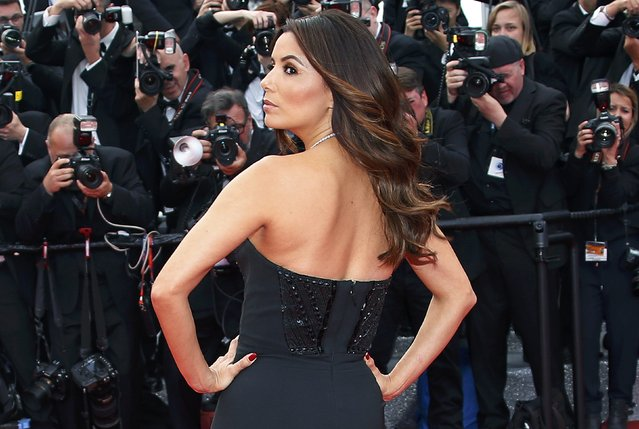 """Actress Eva Longoria poses on the red carpet as she arrives for the screening of the film """"Money Monster"""" out of competition during the 69th Cannes Film Festival in Cannes, France, May 12, 2016. (Photo by Eric Gaillard/Reuters)"""