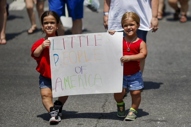 Girls suffering from dwarfism take part in the disability pride parade in New York, July 12, 2015. (Photo by Eduardo Munoz/Reuters)