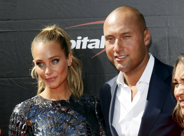 Former MLB baseball player Derek Jeter (R) and model Hannah Davis (L) arrive for the 2015 ESPY Awards in Los Angeles, California July 15, 2015. (Photo by Danny Moloshok/Reuters)