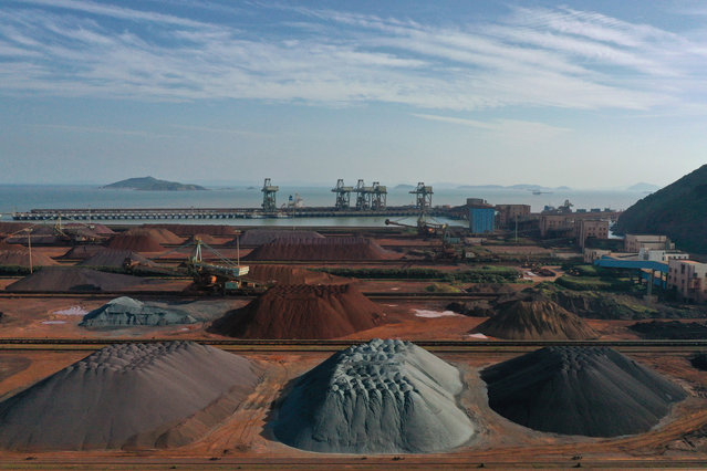Piles of imported iron ore at a port in Zhoushan, China on May 12, 2019. (Photo by Reuters/China Stringer Network)