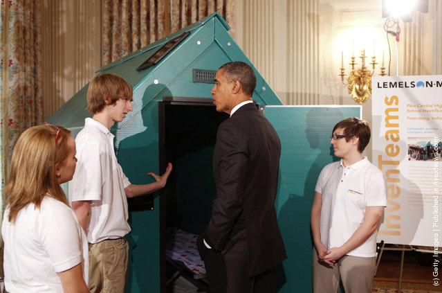 President Barack Obama (2R) discusses a lightweight portable disaster relief shelter designed by Jessica D'Esposito (R), Colton Newton (2L) and Anna Woolery from Petersburg, Indiana, representing the Pike Central High School InvenTeam, while touring student science fair projects on exhibit in the State Dining Room at the White House