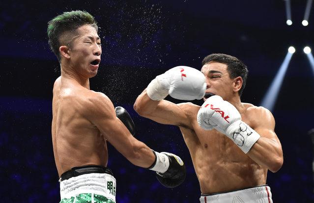 France's Nordine Oubaali (R) fights with of Japan's Takuma Inoue during their WBC bantamweight title boxing match at Saitama Super Arena in Saitama on November 7, 2019. (Photo by Kazuhiro Nogi/AFP Photo)