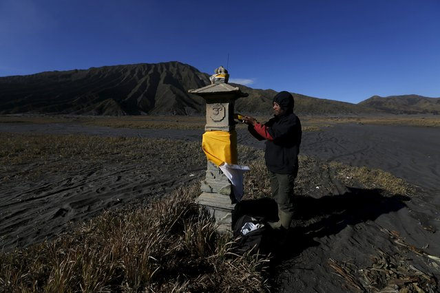 A Hindu villager puts an offering at an altar ahead of the annual Kasada festival at Mount Bromo in Indonesia's East Java province, July 31, 2015. (Photo by Reuters/Beawiharta)