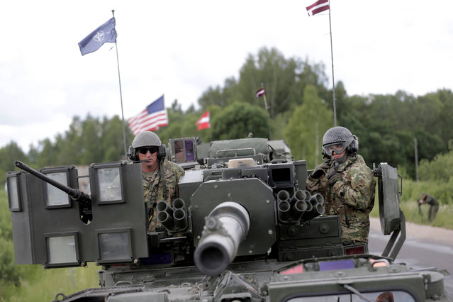 U.S. troops make a stop during tactical road march Dragoon Ride II near Subate, Latvia, June 6, 2016. (Photo by Ints Kalnins/Reuters)