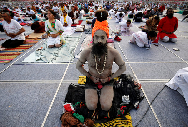 A Sadhu or a Hindu holy man performs yoga during a four-day long camp by yoga guru Baba Ramdev ahead of International Yoga day in Ahmedabad, June 20, 2017. (Photo by Amit Dave/Reuters)