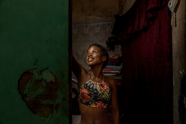 Victoria, 12, at her home in Mangueira. (Photo by Tariq Zaidi/The Guardian)