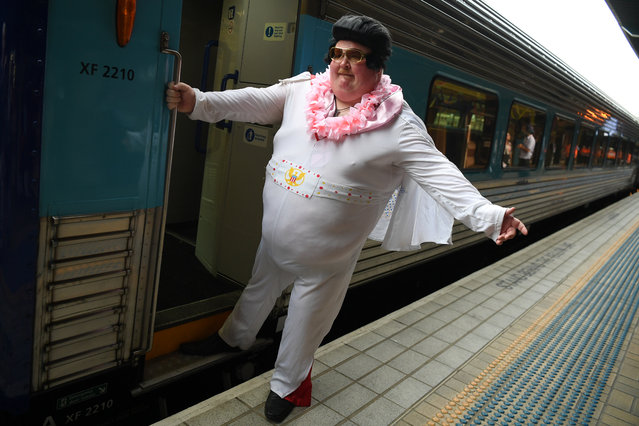 Sean Wright poses for a photo before boarding the Elvis Express, bound for Parkes for the Elvis festival, at Central Station in Sydney, Australia, January 9, 2020. (Photo by Dean Lewins/AAP Image via Reuters)