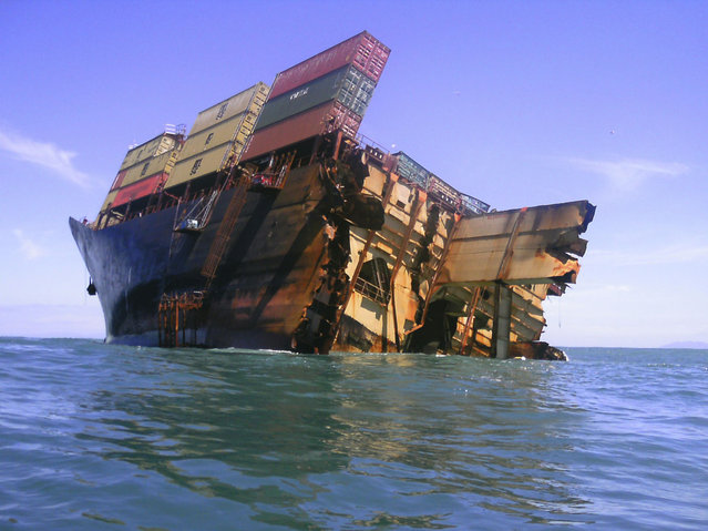 The bow section of the stricken container ship Rena remains above water after the stern broke off and sank about 14 nautical miles (Photo by 22 km) from Tauranga on the east coast of New Zealand's North Island