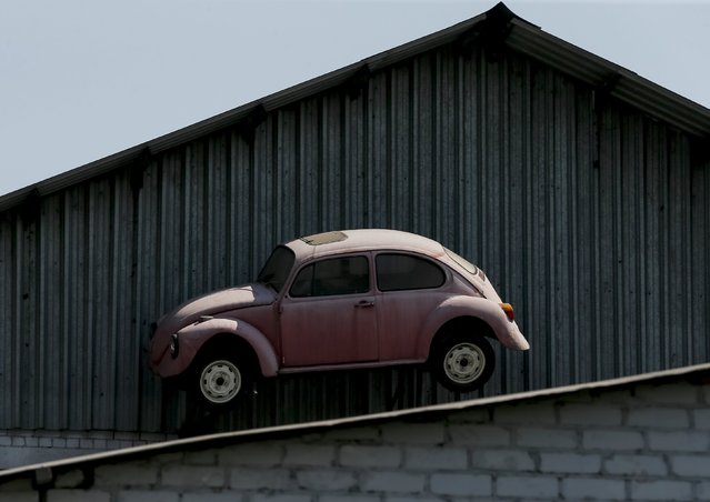 An old car used for advertising is seen at the roof of Phaeton museum in Zaporizhia, Ukraine, August 11, 2015. (Photo by Gleb Garanich/Reuters)