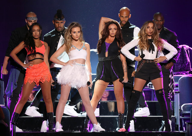"Leigh-Anne Pinnock, from left, Perrie Edwards, Jesy Nelson and Jade Thirlwall of the group ""Little Mix"" perform at the Teen Choice Awards at the Galen Center on Sunday, August 16, 2015, in Los Angeles. (Photo by Matt Sayles/Invision/AP Photo)"