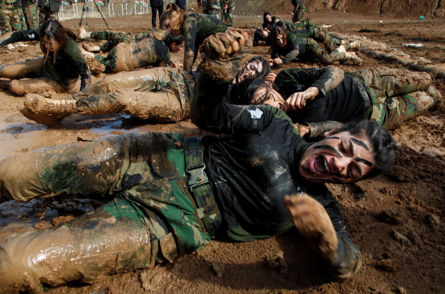 Members of Kurdish Peshmerga Special Forces demonstrate their skills during their graduation ceremony at a military camp in Soran district, in Erbil province, Iraq on February 12, 2020. (Photo by Azad Lashkari/Reuters)