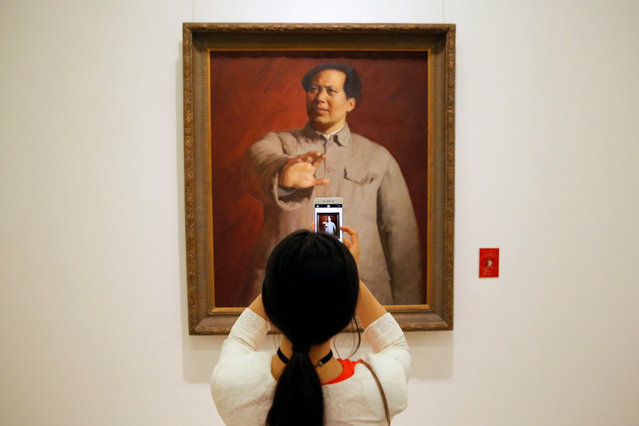 A visitor uses her mobile phone to take a photo of a art work of Chinese former leader Mao Zedong during the exhibition of fine arts works to celebrate the 95th anniversary of the Founding of the Communist Party at the National Museum of China in Beijing city, China, 30 June 2016. The 95th anniversary of the Founding of the Communist Party will fall on 01 July 2016. (Photo by Wu Hong/EPA)