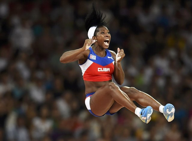 Yarisley Silva of Cuba reacts after clearing a bar as she competes in the women's pole vault final during the 15th IAAF World Championships at the National Stadium in Beijing, China, August 26, 2015. (Photo by Kai Pfaffenbach/Reuters)