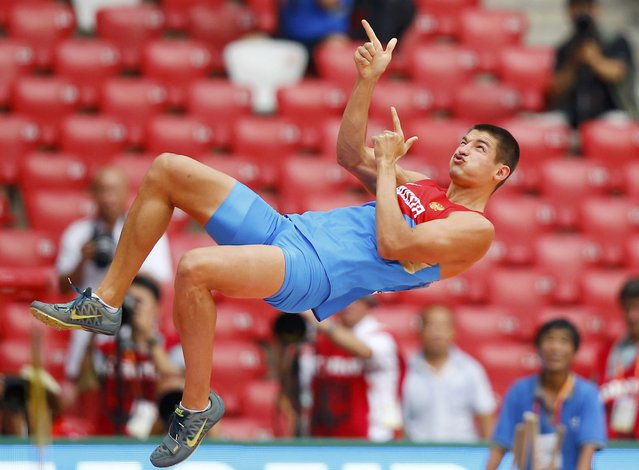 Ilya Shkurenev of Russia reacts as he competes in the pole vault event of the men's decathlon during the 15th IAAF World Championships at the National Stadium in Beijing, China, August 29, 2015.    REUTERS/Kai Pfaffenbach TPX IMAGES OF THE DAY