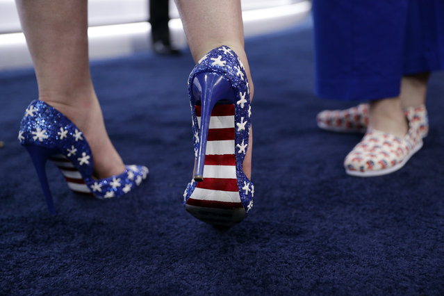 California delegate Felicia Tweedy, left, shows off her shoes during first day of the Republican National Convention in Cleveland, Monday, July 18, 2016. (Photo by John Locher/AP Photo)