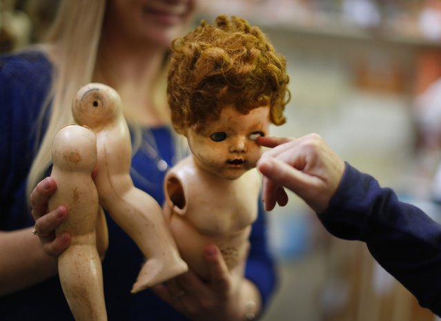 A damaged doll is brought in for repair by a customer at Sydney's Doll Hospital, May 20, 2014. (Photo by Jason Reed/Reuters)